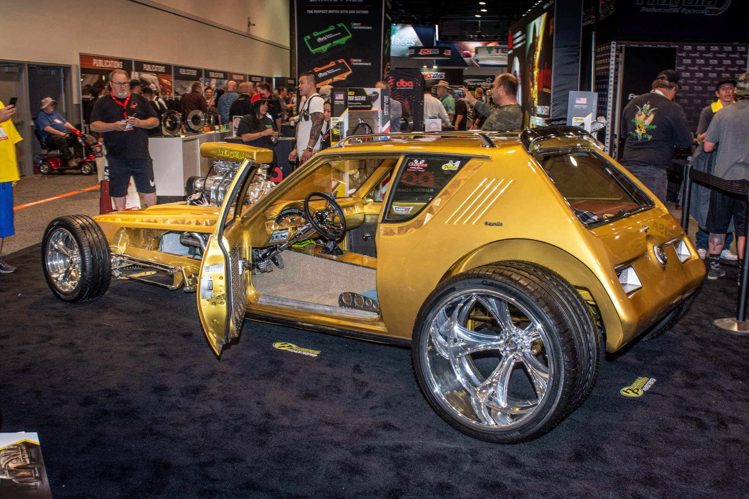 This wild 1975 AMC Gremlin features a supercharged 304ci V8, custom gold paint and a lengthened chassis. It was on display at the 2019 SEMA Show.